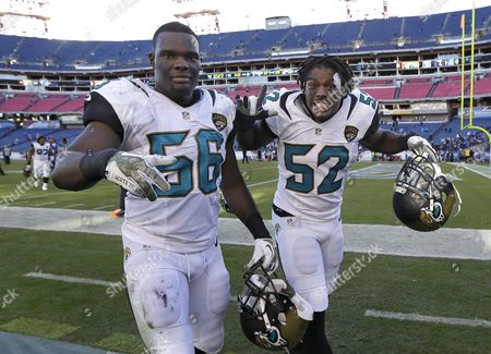 LaRoy Reynolds, J. T. Thomas Jacksonville Jaguars' LaRoy Reynolds (56) and J. T. Thomas (52) celebrate as they leave the field after they defeated the Tennessee Titans 29-27 in an NFL football game, in Nashville, Tenn