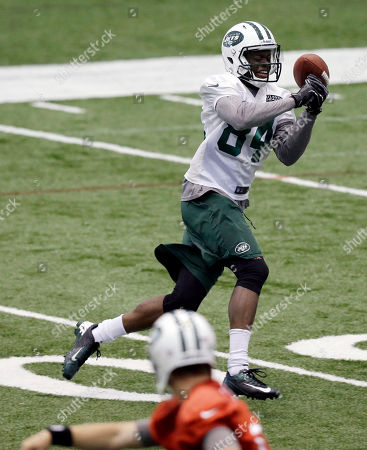 Stephen Hill, Greg McElroy New York Jets wide receiver Stephen Hill (84) tries to hold on to a pass from quarterback Greg McElroy during an NFL football minicamp, in Florham Park, N.J