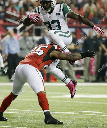 New York Jets running back Chris Ivory (33) leaps over Atlanta Falcons strong safety William Moore (25) during the second half of an NFL football game, in Atlanta