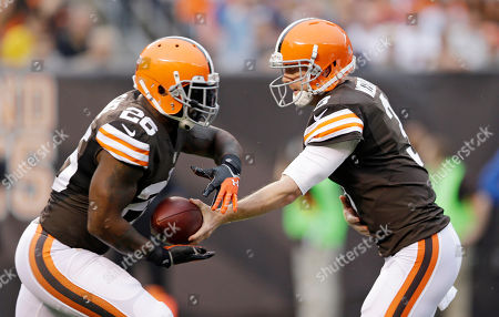Brandon Weeden, Willis McGahee Cleveland Browns quarterback Brandon Weeden, right, hands the ball off to Willis McGahee during an NFL football game between the Detroit Lions and the Browns, in Cleveland