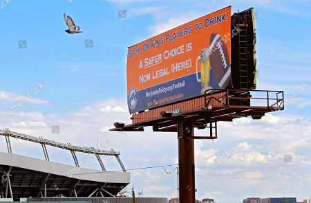 Editorial picture of Marijuana Billboard Football, Denver, USA