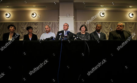 David Frederick, Eleanor Perfetto, Lisa McHale, Kevin Turner, Mary Ann Easterling, Dorsey Levens, Bill Bergey Attorney David Frederick, center, speaks during a news conference, in Philadelphia, after a hearing to determine whether the NFL faces years of litigation over concussion-related brain injuries. Listening, from left Eleanor Perfetto, the widow of former NFL player Ralph Wenzel; Lisa McHale, the widow of former NFL player Tom McHale; former NFL player Kevin Turner, Frederick, Mary Ann Easterling, the widow of former NFL player Ray Easterling, and former NFL players Dorsey Levens, and Bill Bergey