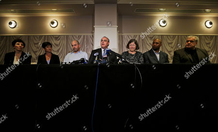 Stock Photo of David Frederick, Eleanor Perfetto, Lisa McHale, Kevin Turner, Mary Ann Easterling, Dorsey Levens, Bill Bergey Attorney David Frederick, center, speaks during a news conference in Philadelphia, after a hearing to determine whether the NFL faces years of litigation over concussion-related brain injuries. Listening, from left Eleanor Perfetto, the widow of former NFL player Ralph Wenzel; Lisa McHale, the widow of former NFL player Tom McHale; former NFL player Kevin Turner, Frederick, Mary Ann Easterling, the widow of former NFL player Ray Easterling, and former NFL players Dorsey Levens, and Bill Bergey. Judge Anita Brody has announced, that the NFL and more than 4,500 former players want to settle concussion-related lawsuits for $765 million