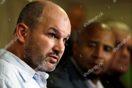 Stock Image of Kevin Turner, Dorsey Levens, Bill Bergey Former NFL player Kevin Turner, left, speaks as former players Dorsey Levens, center, and Bill Bergey listen during a a news conference in Philadelphia, after a hearing to determine whether the NFL faces years of litigation over concussion-related brain injuries. Turner, a former NFL and University of Alabama player, has died after battling Lou Gehrig's disease, his father said in a statement . He was 46
