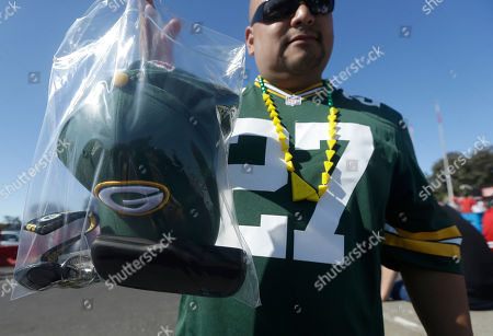 Green Bay Packers fan Rene Reyes shows a his belongings in a clear plastic security bags in the Candlestick Park parking lot before an NFL football game between the San Francisco 49ers and the Green Bay Packers in San Francisco
