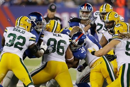 Brandon Jacobs New York Giants running back Brandon Jacobs (34) pushes past Green Bay Packers' Mike Neal (96) for a first down during the first half of an NFL football game, in East Rutherford, N.J