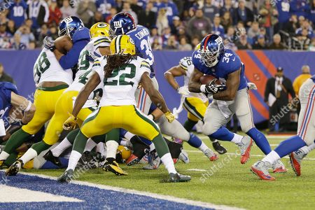 Brandon Jacobs New York Giants running back Brandon Jacobs (34) rushes past Green Bay Packers' Jerron McMillian (22) for a touchdown during the second half of an NFL football game, in East Rutherford, N.J