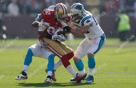 Mario Manningham, Luke Kuechly, Captain Munnerlyn San Francisco 49ers wide receiver Mario Manningham (82) is tackled by Carolina Panthers cornerback Captain Munnerlyn, rear, and middle linebacker Luke Kuechly during the first quarter of an NFL football game in San Francisco