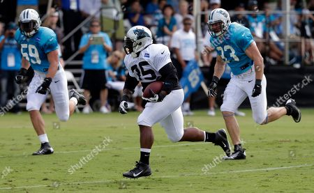 Mike Tolbert, Luke Kuechly, Chase Blackburn Carolina Panthers' Mike Tolbert (35) runs for the end zone as Chase Blackburn (93) and Luke Kuechly (59) pursue during an NFL football training camp practice in Spartanburg, S.C