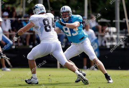 Stock Picture of Chase Blackburn, Ben Hartsock Carolina Panthers' Chase Blackburn (93) chases Ben Hartsock (84) during an NFL football training camp practice in Spartanburg, S.C