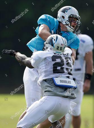 Chase Blackburn, Kenjon Barner Carolina Panthers' Chase Blackburn, top, tries to run past Kenjon Barner, bottom, during an NFL football training camp practice in Spartanburg, S.C