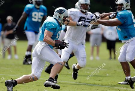 Chase Blackburn Carolina Panthers' Chase Blackburn, left, returns an interception during an NFL football training camp practice in Spartanburg, S.C