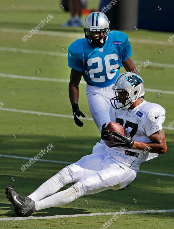 Stock Picture of Domenik Hixon, DJ Campbell Carolina Panthers' Domenik Hixon (87) catches a pass in front of D.J. Campbell (26) during practice at NFL football training camp in Spartanburg, S.C