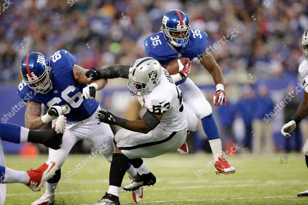 Andre Brown, David Diehl, Nick Roach New York Giants running back Andre Brown (35) bounces off Oakland Raiders middle linebacker Nick Roach (53) as guard David Diehl (66) defends on the play during the first half of an NFL football game, in East Rutherford, N.J