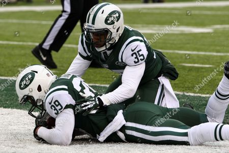 Stock Image of Antonio Allen, Isaiah Trufant New York Jets free safety Antonio Allen, left, recovers the ball in the end zone after he blocked a punt by Oakland Raiders punter Marquette King as defensive back Isaiah Trufant (35) assists on the play during the first half of an NFL football game, in East Rutherford, N.J
