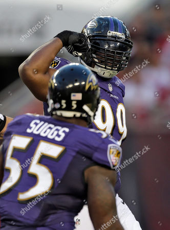 Chris Canty, Terrell Suggs Baltimore Ravens defensive tackle Chris Canty (99) flexes his muscles to teammate outside linebacker Terrell Suggs (55) after sacking Tampa Bay Buccaneers quarterback Josh Freeman during the first quarter of an NFL preseason football game, in Tampa, Fla