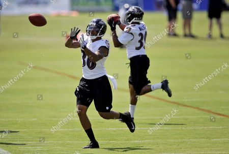 Gary Walker, Marc Anthony Baltimore Ravens cornerback Marc Anthony, front, prepares to catch a pass as he and teammate Gary Walker run a drill during NFL football training camp at the team's practice facility in Owings Mills, Md