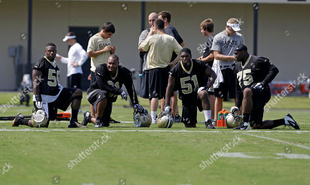 Curtis Lofton, Will Smith, Jonathan Vilma, Tyrunn Walker Left to right, New Orleans Saints middle linebacker Curtis Lofton (50), linebacker Will Smith (91), outside linebacker Jonathan Vilma (51), and defensive end Tyrunn Walker (75) during their NFL football training camp in Metairie, La