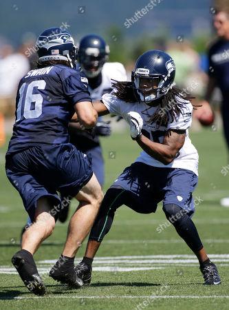 Stock Photo of Richard Sherman Seattle Seahawks' Richard Sherman, right, defends against Brett Swain during NFL football training camp, in Renton, Wash