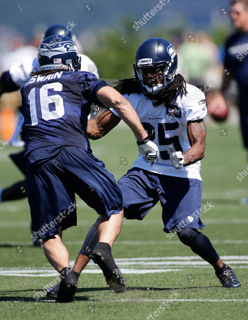 Stock Picture of Richard Sherman Seattle Seahawks' Richard Sherman, right, defends against Brett Swain during NFL football training camp, in Renton, Wash