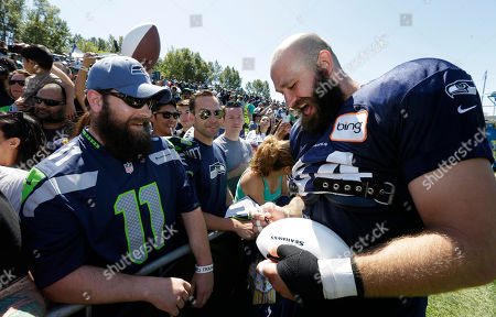 Sean McGrath Seattle Seahawks tight end Sean McGrath, right, laughs as he trades beard comments with fan David Thornton, left, of Marysville, Wash., as McGrath signs autographs following an NFL football training camp practice, in Renton, Wash