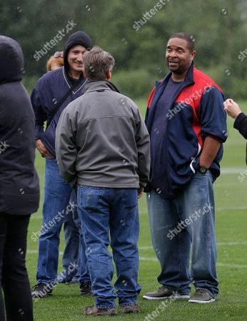 """Sir Mix-a-Lot, Anthony Ray Rapper and musician Anthony Ray, also known as """"Sir Mix-a-Lot,"""" right, talks with guests as he attends Seattle Seahawks NFL football training camp, in Renton, Wash"""