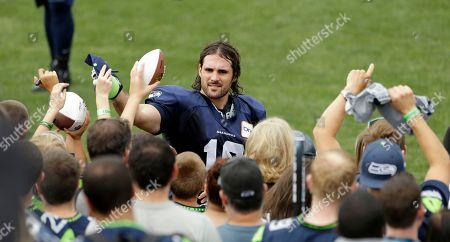 Brett Swain Seattle Seahawks' Brett Swain signs autographs following an NFL football training camp, in Renton, Wash