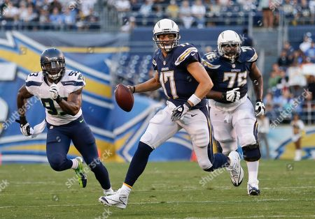 Philip Rivers, O Brien Schofield San Diego Chargers quarterback Philip Rivers scrambles away from Seattle Seahawks linebacker O'Brien Schofield in the first quarter of an NFL preseason football game, in San Diego