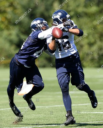 Brett Swain, Byron Maxwell Seattle Seahawks' Byron Maxwell, left, knocks the ball away from Brett Swain during NFL football training camp, in Renton, Wash