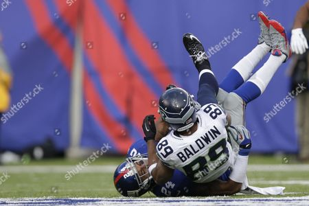 Doug Baldwin, Terrell Thomas Seattle Seahawks wide receiver Doug Baldwin (89) is tackled by New York Giants cornerback Terrell Thomas (24) during the first half of an NFL football game, in East Rutherford, N.J