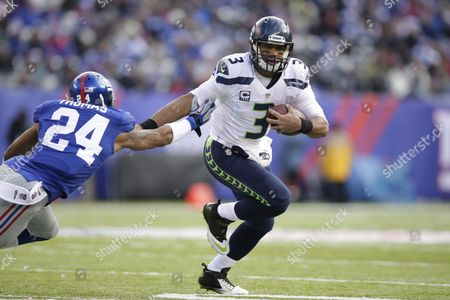 Russell Wilson, Terrell Thomas Seattle Seahawks quarterback Russell Wilson (3) stiff arms New York Giants cornerback Terrell Thomas (24) during the first half of an NFL football game, in East Rutherford, N.J