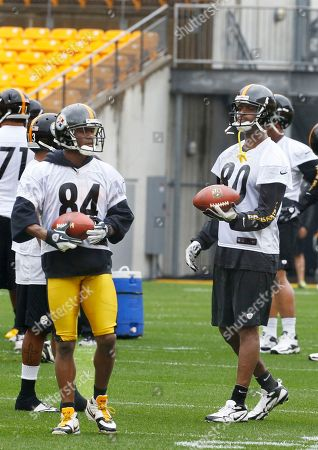 Antonio Brown, Plaxico Burress Pittsburgh Steelers wide receivers Antonio Brown (84) and Plaxico Burress (80) walk back after making catches in drills during the NFL football practice on in Pittsburgh