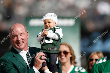 Marty Lyons Former New York Jets defensive tackle Marty Lyons holds his nearly one-year old granddaughter Liv Lyons during a halftime ceremony in which he was honored by the Jets in an NFL football game between the New York Jets and the Pittsburgh Steelers, in East Rutherford, N.J