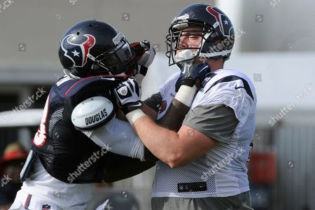 Houston Texans linebacker Willie Jefferson, left, and tackle Andrew Gardner go head to head during the team's NFL football training camp, in Houston