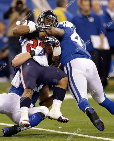 Dennis Johnson, Weslye Saunders Indianapolis Colts' Weslye Saunders, right, tackles Houston Texans' Dennis Johnson during the second half of an NFL football game in Indianapolis