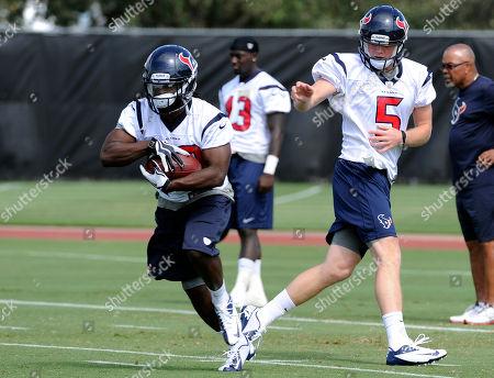 Collin Klein Houston Texans rookie quarterback Collin Klein (5) hands the ball off to Deji Karim during workouts at the Texans' NFL football rookie mini camp, in Houston