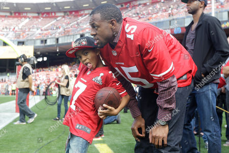 Andre Iguodala Golden State Warriors basketball player Andre Iguodala watches as players warm up with his son Andre Jr, 6, before an NFL preseason football game between the San Francisco 49ers and the Minnesota Vikings in San Francisco