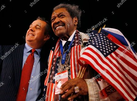 Boxing promoter Don King, right, poses with a guest before the presidential debate between Democratic presidential nominee Hillary Clinton and Republican presidential nominee Donald Trump at Hofstra University in Hempstead, N.Y