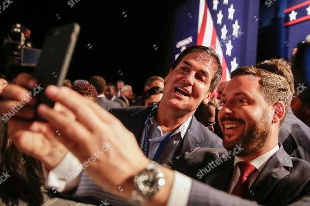 Businessman Mark Cuban and Michael Kives pose for a selfie before the presidential debate between Democratic presidential nominee Hillary Clinton and Republican presidential nominee Donald Trump at Hofstra University in Hempstead, N.Y
