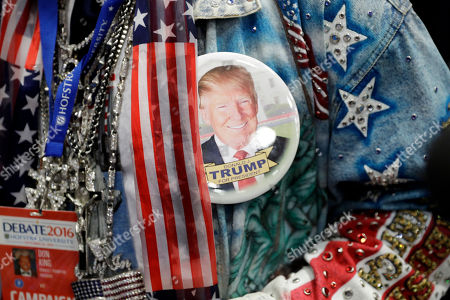 Boxing promoter Don King wears a button in support of Donald Trump before the presidential debate between Democratic presidential candidate Hillary Clinton and Republican presidential candidate Donald Trump at Hofstra University in Hempstead, N.Y