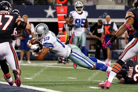 Chris Conte, Miles Austin, D.J. Moore, Lance Briggs Dallas Cowboys wide receiver Miles Austin (19) dives through a tackle by Chicago Bears cornerback D.J. Moore (30) to score a touchdown during the first half of an NFL football game, in Arlington, Texas