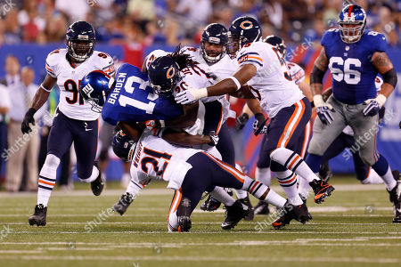 Ramses Barden, Major Wright New York Giants wide receiver Ramses Barden (13) is tackled by Chicago Bears' Major Wright (21) and Tim Jennings (26) during the first half of an NFL preseason football game, in East Rutherford, N.J