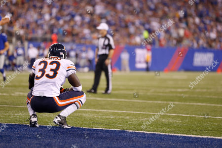 Charles Tillman Chicago Bears defensive back Charles Tillman (33) reacts after New York Giants wide receiver Ramses Barden (13) caught a touchdown pass during the first half of an NFL preseason football game, in East Rutherford, N.J