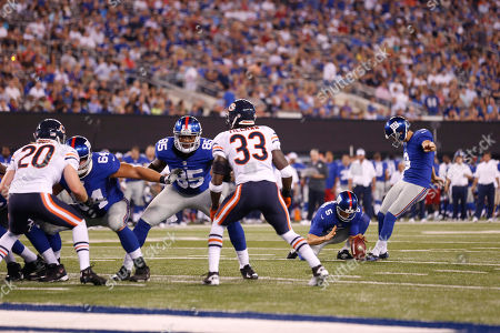 Lawrence Tynes New York Giants kicker Lawrence Tynes (9) kicks the extra point after a touchdown by Ramses Barden (13) during the first half of an NFL preseason football game against the Chicago Bears, in East Rutherford, N.J
