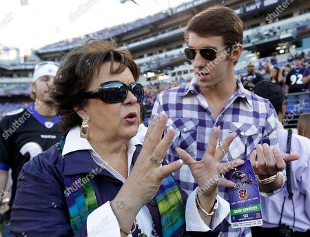 Michael Phelps, Debbie Phelps Olympic swimmer Michael Phelps, right, speaks with his mother, Debbie, on the sideline before an NFL football game between the Baltimore Ravens and the Cincinnati Bengals in Baltimore