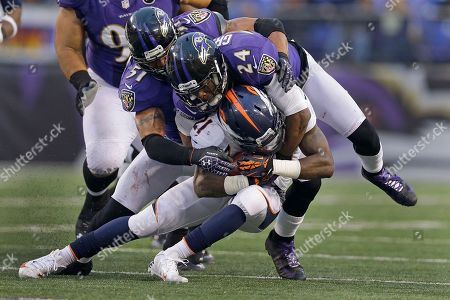 Brendon Ayanbadejo, Corey Graham, Ronnie Hillman Baltimore Ravens inside linebacker Brendon Ayanbadejo (51), cornerback Corey Graham (24) stop Denver Broncos running back Ronnie Hillman during the second half of an NFL football game in Baltimore, . The Broncos defeated the Ravens 34-17
