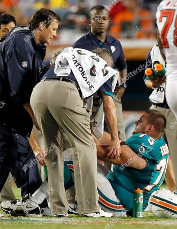 Nate Garner Miami Dolphins offensive tackle Nate Garner (75) is helped after he injured himself during the second half of an NFL preseason football game against the Tampa Bay Buccaneers, in Miami