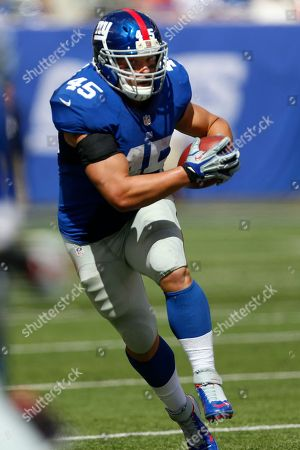 Henry Hynoski New York Giants running back Henry Hynoski runs with the ball after catching a pass from quarterback Eli Manning during the first half of an NFL football game against the Tampa Bay Buccaneers, in East Rutherford, N.J