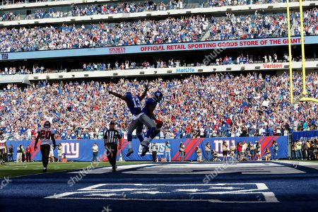 Martellus Bennett, Ramses Barden New York Giants wide receiver Ramses Barden (13) and Martellus Bennett celebrate a touchdown by Bennett during the second half of an NFL football game against the Tampa Bay Buccaneers, in East Rutherford, N.J. The Giants won the game 41-34