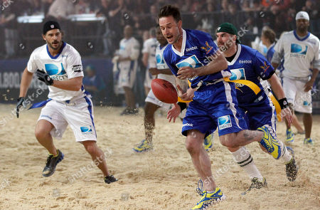 David Arquette, Brandon Molale, Joe Manganiello Actor David Arquette, center, drops a pass fellow actors Brandon Molale, right, and Joe Manganiello, left, look on during the Celebrity Beach Bowl, part of the festivities for NFL football's Super Bowl XLVI, in Indianapolis